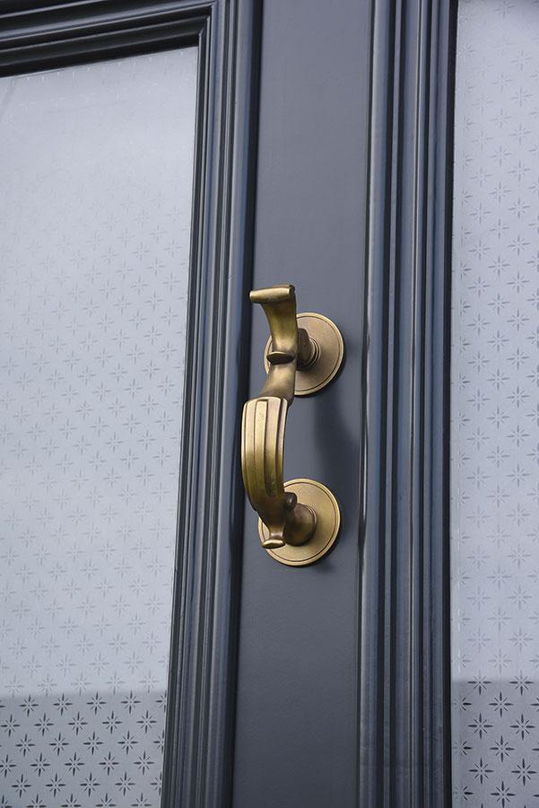 blue wooden door with brass brushed metal door knocker