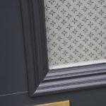 blue wooden front door with brass metal letterbox