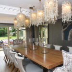 dining room view of cream wooden bifold doors