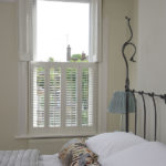white wooden bedroom window