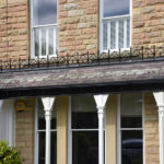 white wooden front sash windows