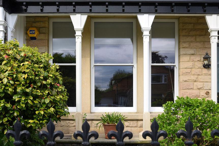 three large white wood front windows